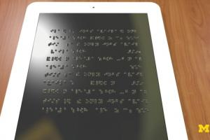 artist impression van een tablet met braille